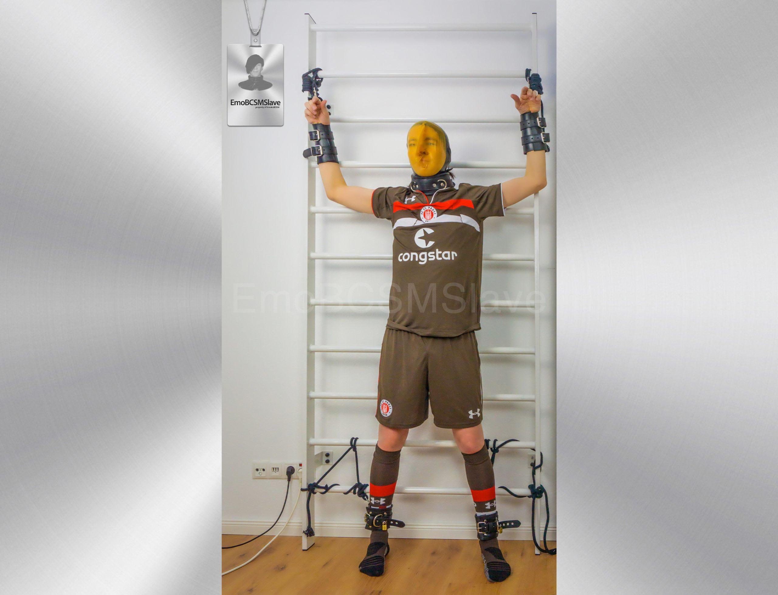 Soccer EmoBCSMSlave tied to wall bars and vacuum mask